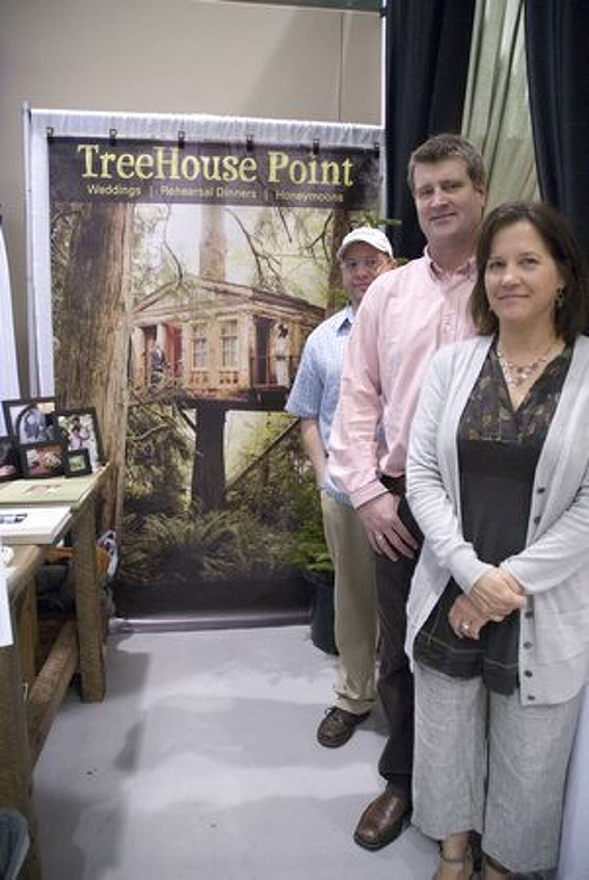Pete Nelson and Judy Nelson (right) stand in front of their booth for Treehouse Point, an events facility that can hold ceremonies in treetops. The 20th annual Seattle Wedding Show took place at the Washington State Convention and Trade Center Jan. 16-17. Read about the 5 coolest booths at the show here. (Rebecca Livingston/seattlepi.com)