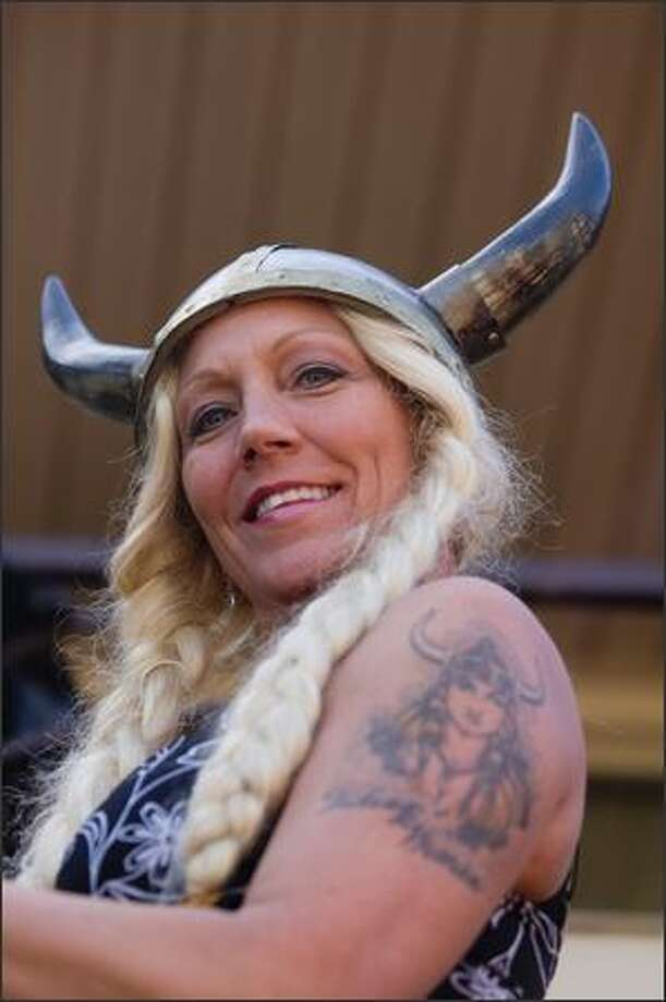 Lisa Hageselle's Viking hat matches the Viking tattoo on her arm while marching during the Norwegian Constitution Day parade in Ballard Sunday. Photo: Daniel Berman, Seattlepi.com