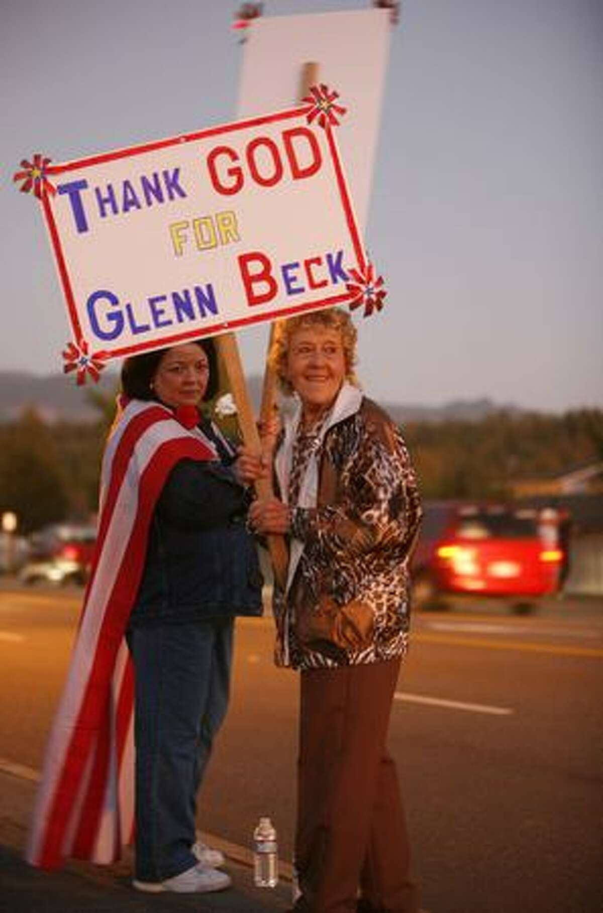 Supporters stand outside McIntyre Hall Performing Arts and Conference Center in Mount Vernon as FOX News host Glenn Beck prepares to receive the key to the city.