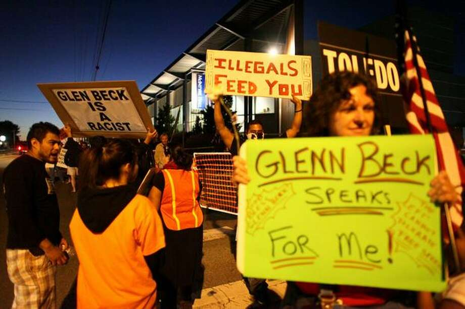 Protesters march in front of McIntyre Hall Performing Arts and Conference Center in Mount Vernon as FOX News host Glenn Beck receives the key to the city. Photo: Joshua Trujillo, Seattlepi.com
