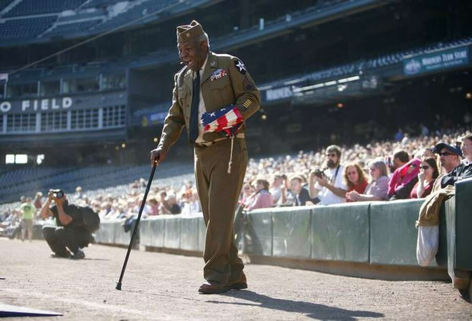 Korean War veteran and actor James McEachin tells a story to the audience about being a veteran during the Evergreen Freedom Foundation's Take the Field with Glenn Beck event at Safeco Field on Saturday. Photo: Joshua Trujillo, Seattlepi.com
