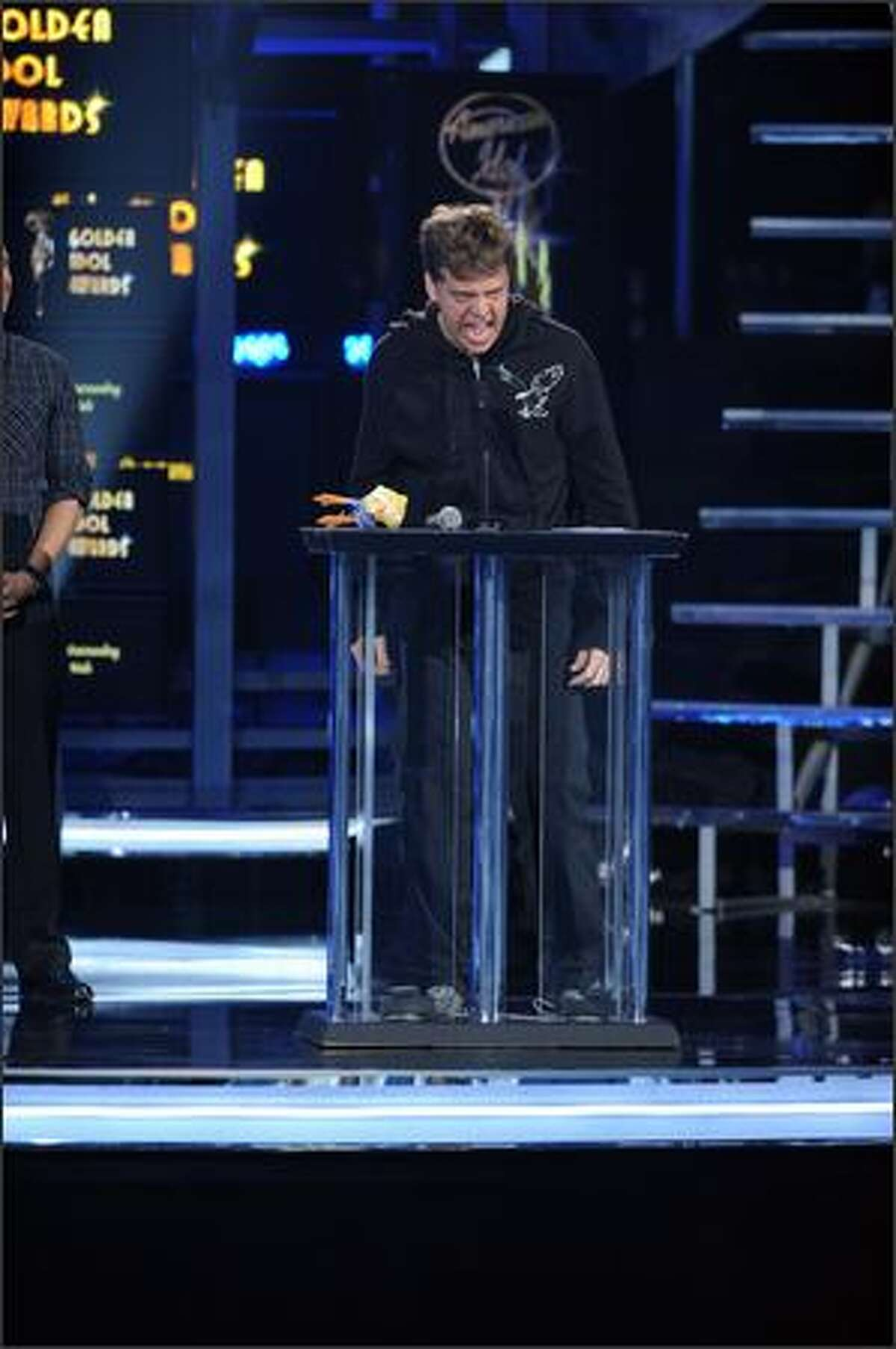 Nick Mitchell is awarded the Golden American Idol Award for best outstanding male performance.