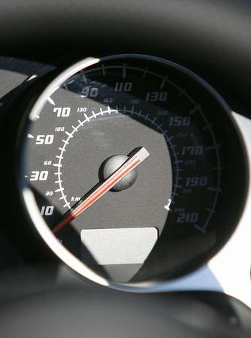 A speedometer is shown in a Lamborghini roadster during the dedication ceremony for the Automobili Lamborghini Advanced Composite Structures Laboratory.