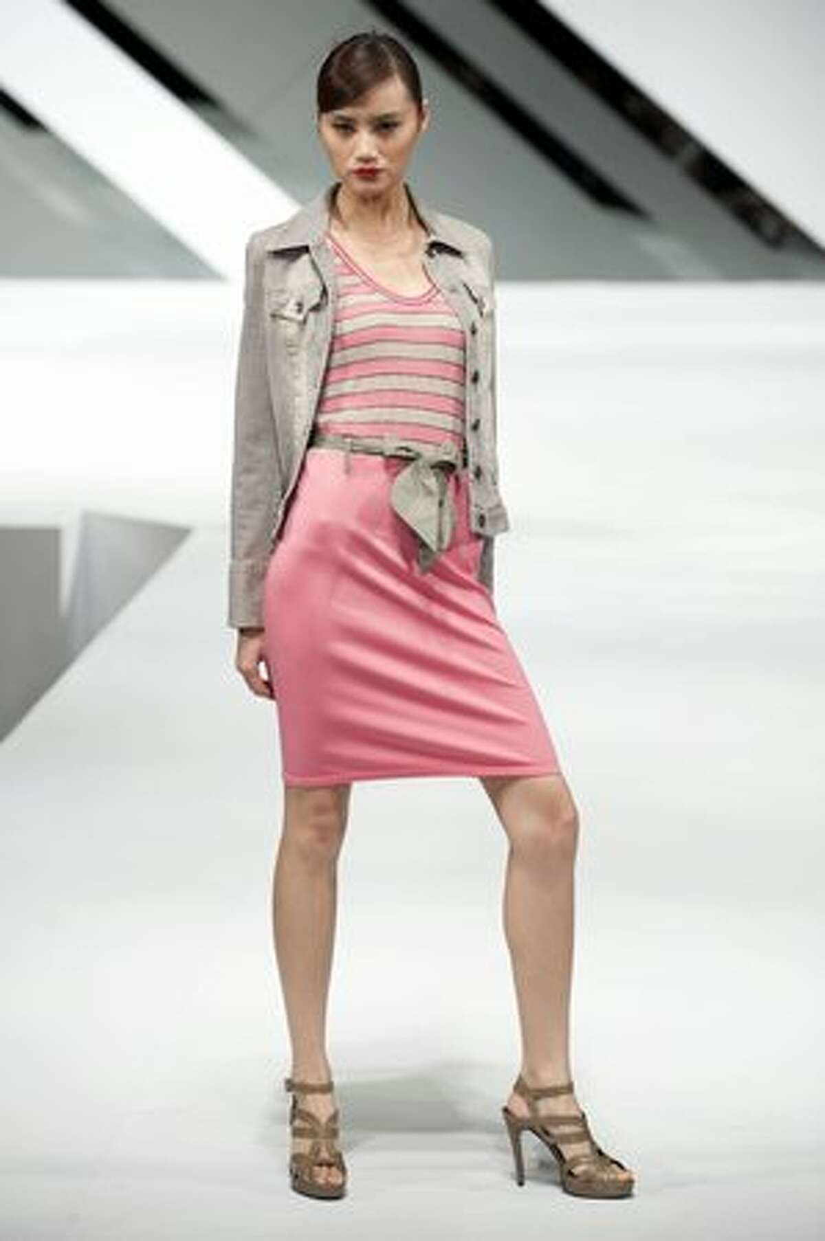 A model showcases a design by William Tang on the catwalk during the Marccain show as part of the Hong Kong Fashion Week fall/winter 2010 on Monday, Jan. 18, 2010 in Hong Kong.