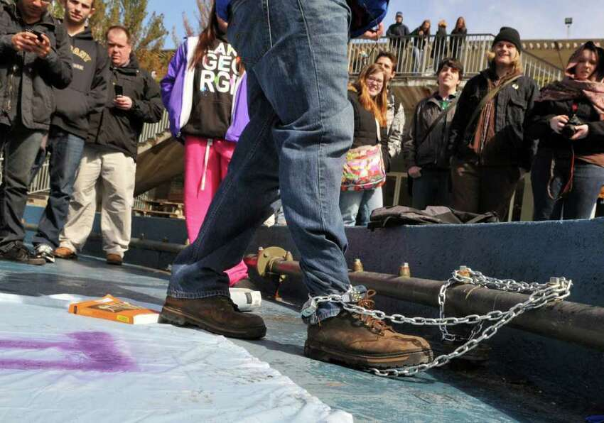 UAlbany student and veteran, Chris Schewe, 41, of Pittstown speaks to fellow students after chaning himself to the fountain at UAlbany's main campus in Albany Friday morning March 25, 2011. (John Carl D'Annibale / Times Union)