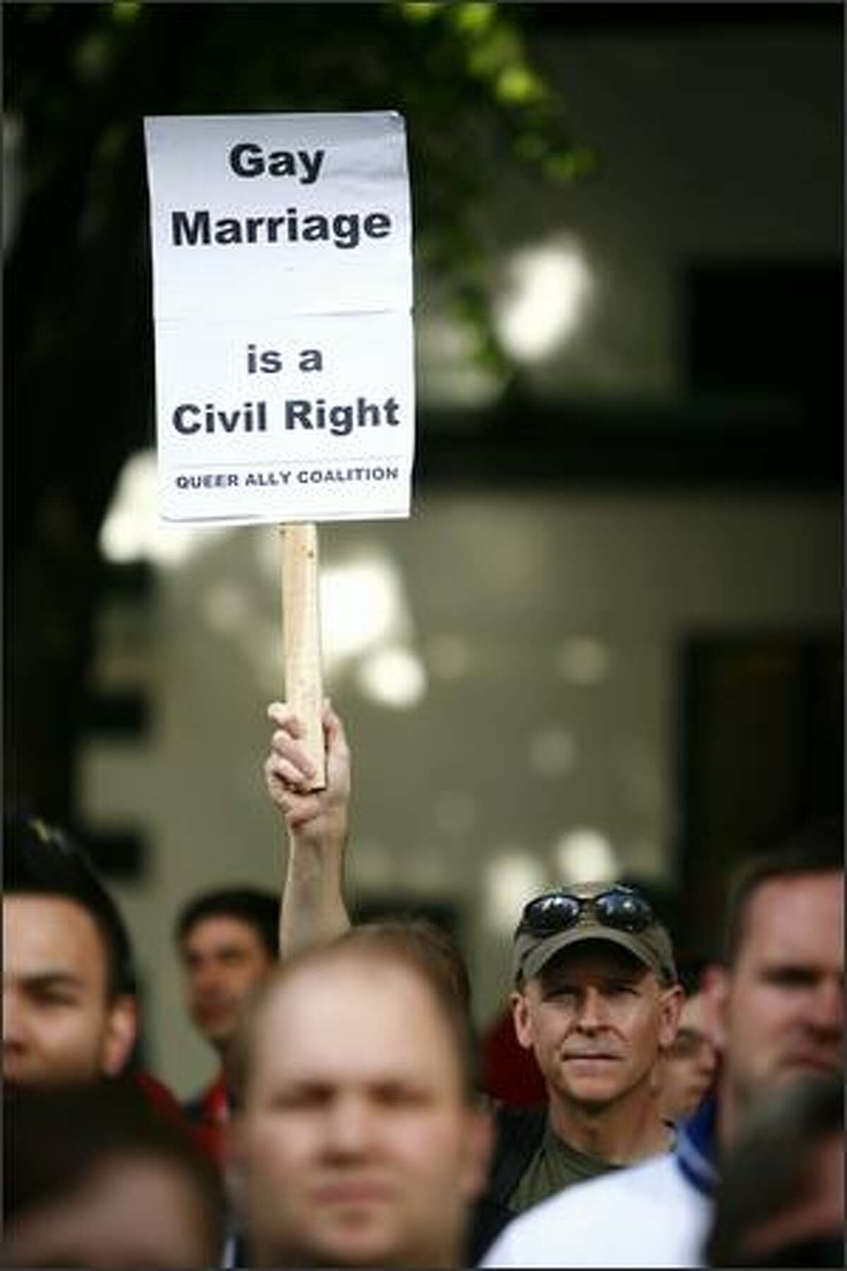 A protestor holds up a sign during the rally.