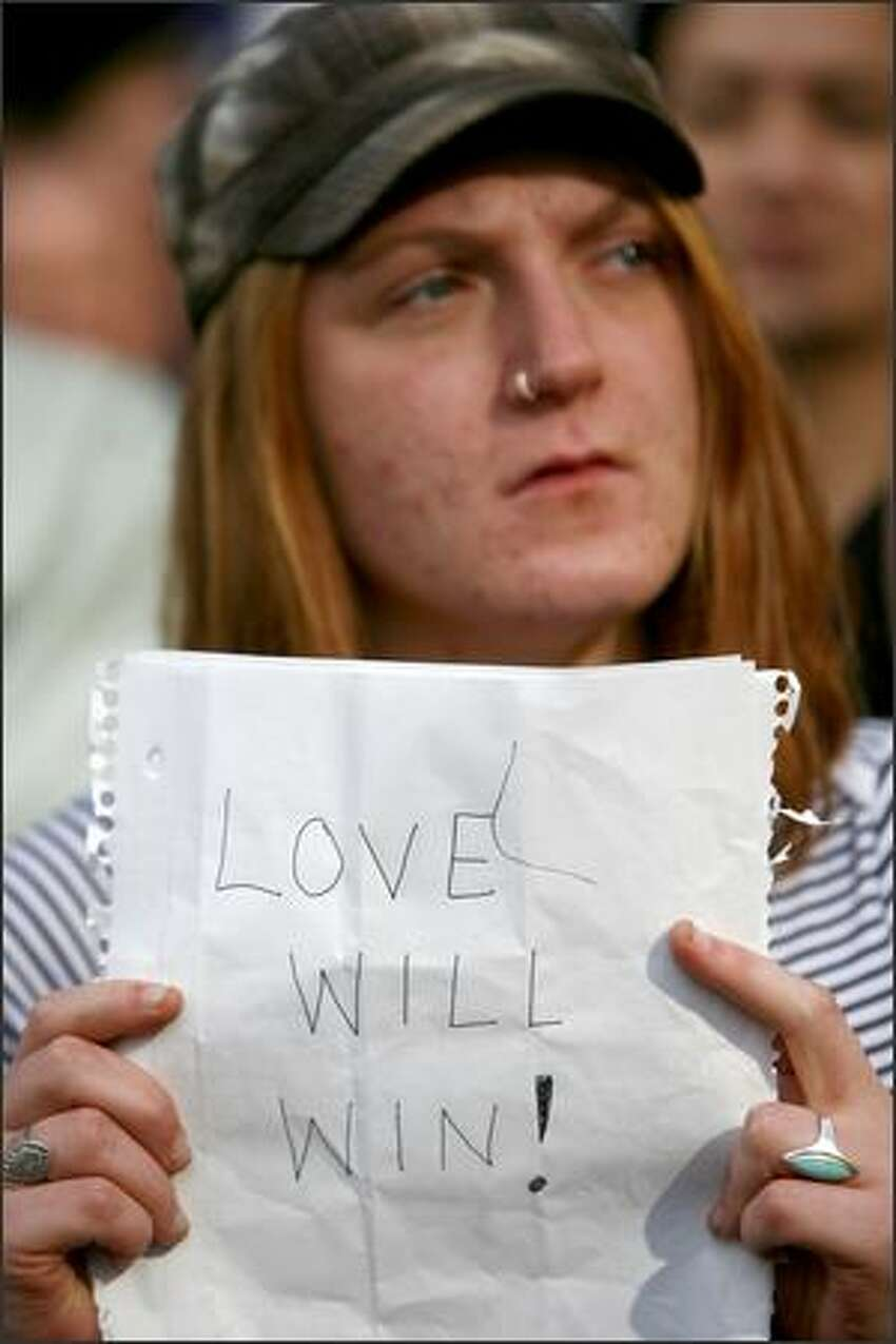 A protester holds up a sign during the rally.