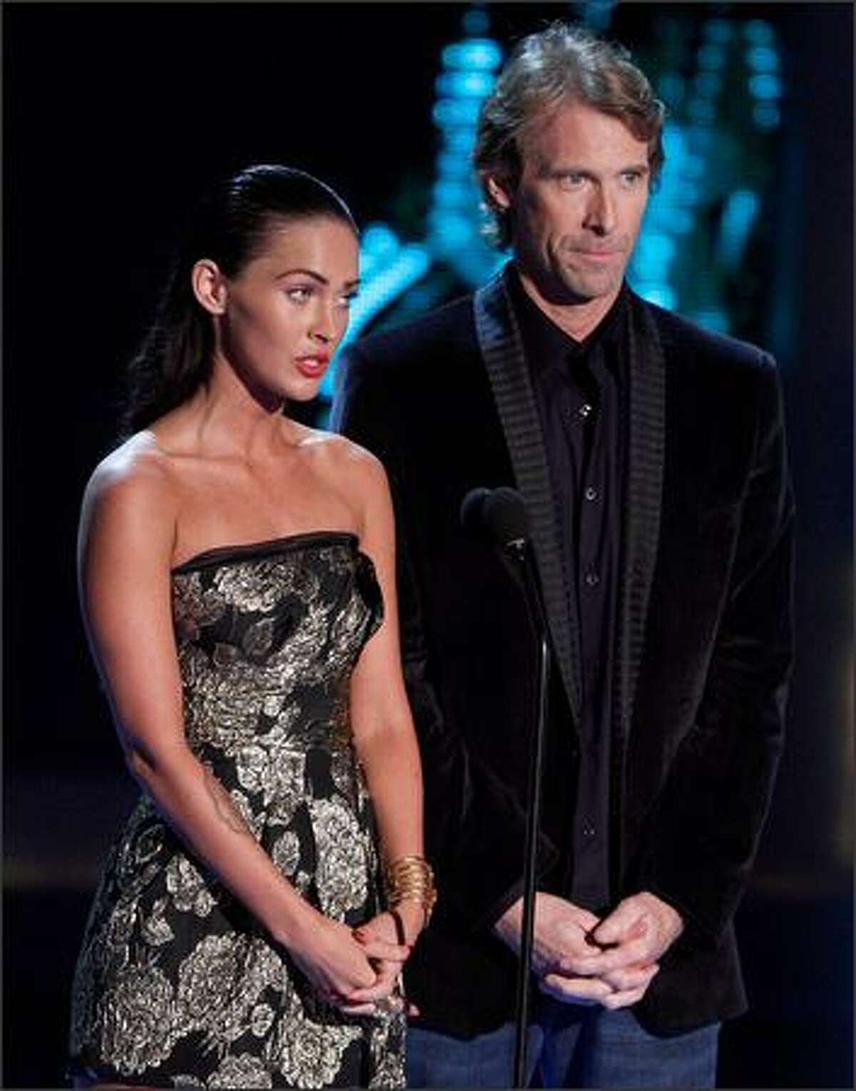Actress Megan Fox, left, and director Michael Bay speak onstage during the 18th Annual MTV Movie Awards held at the Gibson Amphitheatre on Sunday in Universal City, Calif.