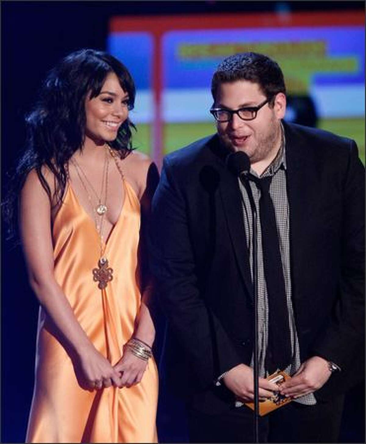 Actress Vanessa Hudgens, left, and actor Jonah Hill present the Breakthrough Male Performance award onstage during the 18th Annual MTV Movie Awards held at the Gibson Amphitheatre on Sunday in Universal City, Calif.