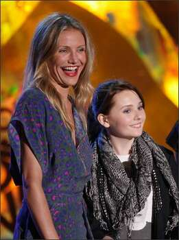 Actresses Cameron Diaz and Abigail Breslin present the Best Female Performance award onstage during the 18th Annual MTV Movie Awards held at the Gibson Amphitheatre on Sunday in Universal City, Calif. Photo: Getty Images