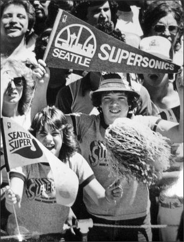 A fan waves a banner in 1979. (seattlepi.com file)