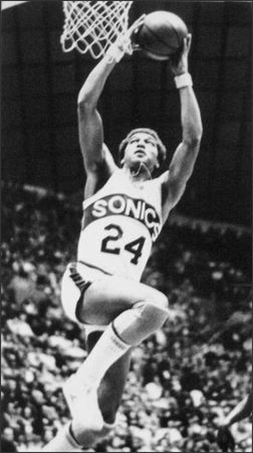 Dennis Johnson leaps to make a basket. 1977-78. (seattlepi.com file)