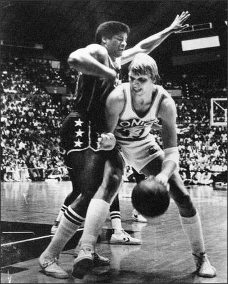 Jack  Sikma found the very large frame of Wes Unseld blocking his way as he made a move to the basket during the NBA playoff game against Washington at the Coliseum. The Sonics won a knee-knocker, 114-112, in overtime to take a 3-1 lead in the championship series. (seattlepi.com file)