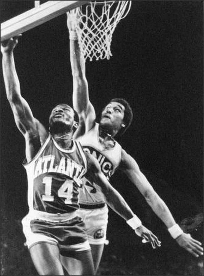 In ballet unison, Dennis Johnson of the Seattle Sonics went up to attempt a short block on Atlanta's Charlie Criss during NBA action in the Kingdome in February of 1979. Back home again, the Supers broke a four-game losing streak to beat the Georgia team, 116-104. (seattlepi.com file)
