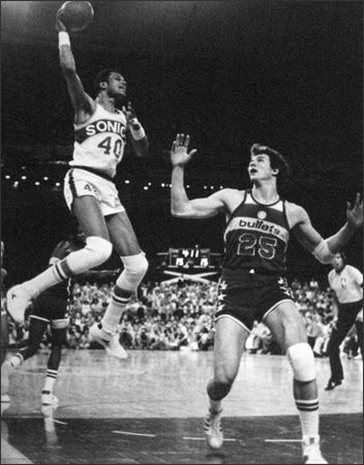 Marvin Webster of the Seattle Sonics would be airborn a few more times that day in 1978 as the tense NBA championship series continued in Landover, Md., with Game No. 6. Watching No. 40 is Baltimore Bullets rival Mitch Kupchak (25). (seattlepi.com file)