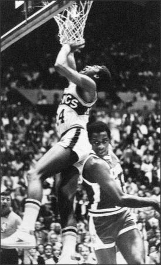 Dennis Johnson went up for a layup against Denver's David Thomson as the Seattle Sonics started fast and finished at the same tempo to blow out the Nuggets, 123-108, and win the NBA's Western Conference Championship. (seattlepi.com file)