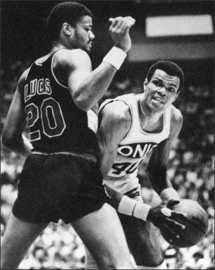 Seattle SuperSonic Marvin Webster, right, has the ball ready as Portland Trail Blazer Maurice Lucas tries to cut him off from the basket in first quarter play in the final game of the NBA Western Conference semi-finals at the Seattle Center Coliseum. The Sonics won 105-94. (seattlepi.com file)