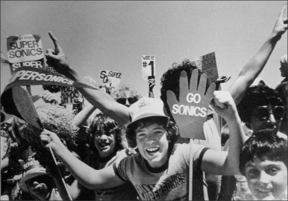 These were only a few of the estimated 30,000 that jammed a cargo terminal area at Seattle-Tacoma Airport in June of 1979 to welcome back the world championship SuperSonics. The celebration that had begun with the Sonics' 97-93 series-clinching victory over the Washington Bullets continued for four days and included a planned celebration parade. (seattlepi.com file)