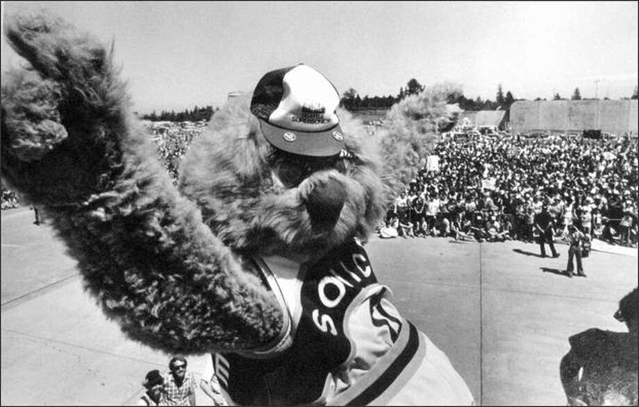 The Wheedle also debarked from the plane that carried the Sonics back from Washington, D.C in June of 1979. He raised his arms and lofted his forefinger in the traditional No. 1 salute in front of an estimated crowd of 30,000 at Sea-Tac. (seattlepi.com file)