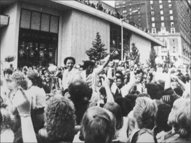 Sonics are greeted by fans during a celebration parade.  1979. (seattlepi.com file)