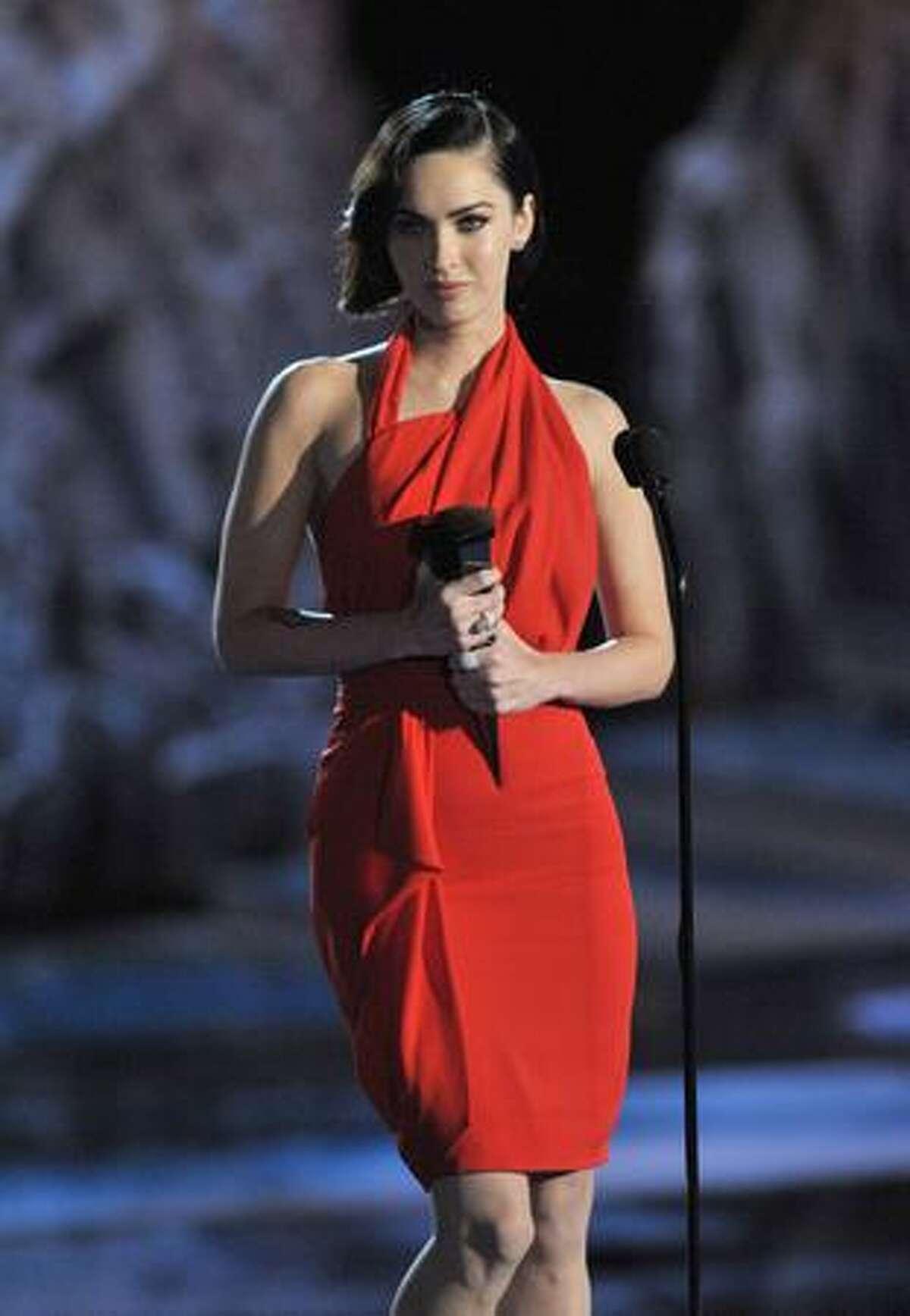 Actress Megan Fox accepts the Best Sci-Fi Actress award onstage.