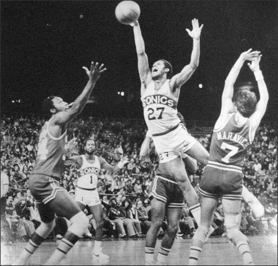 John Johnson (27) of the Sonics lost control of the ball in mid-air as he tried to get between a couple of New Orleans players during a NBA game November of 1978 in the Kingdome. The Sonics extended their sizzling early season pace with an easy victory over the outclassed Jazz. (seattlepi.com file)