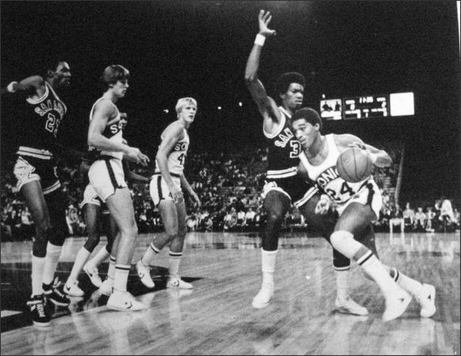 Sonic Dennis Johnson drove to the basket. Seattle thrashed San Antonio in the Dome. 1978-79 season. (seattlepi.com file)