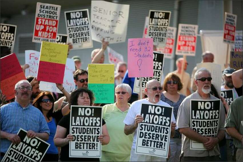 Protesters, including teachers, parents, students and union members chant and hold signs during a protest in recent reduction in force (RIF) layoffs within Seattle Public Schools at the John Stanford Center for Educational Excellence on June, 3, 2009 in Seattle.