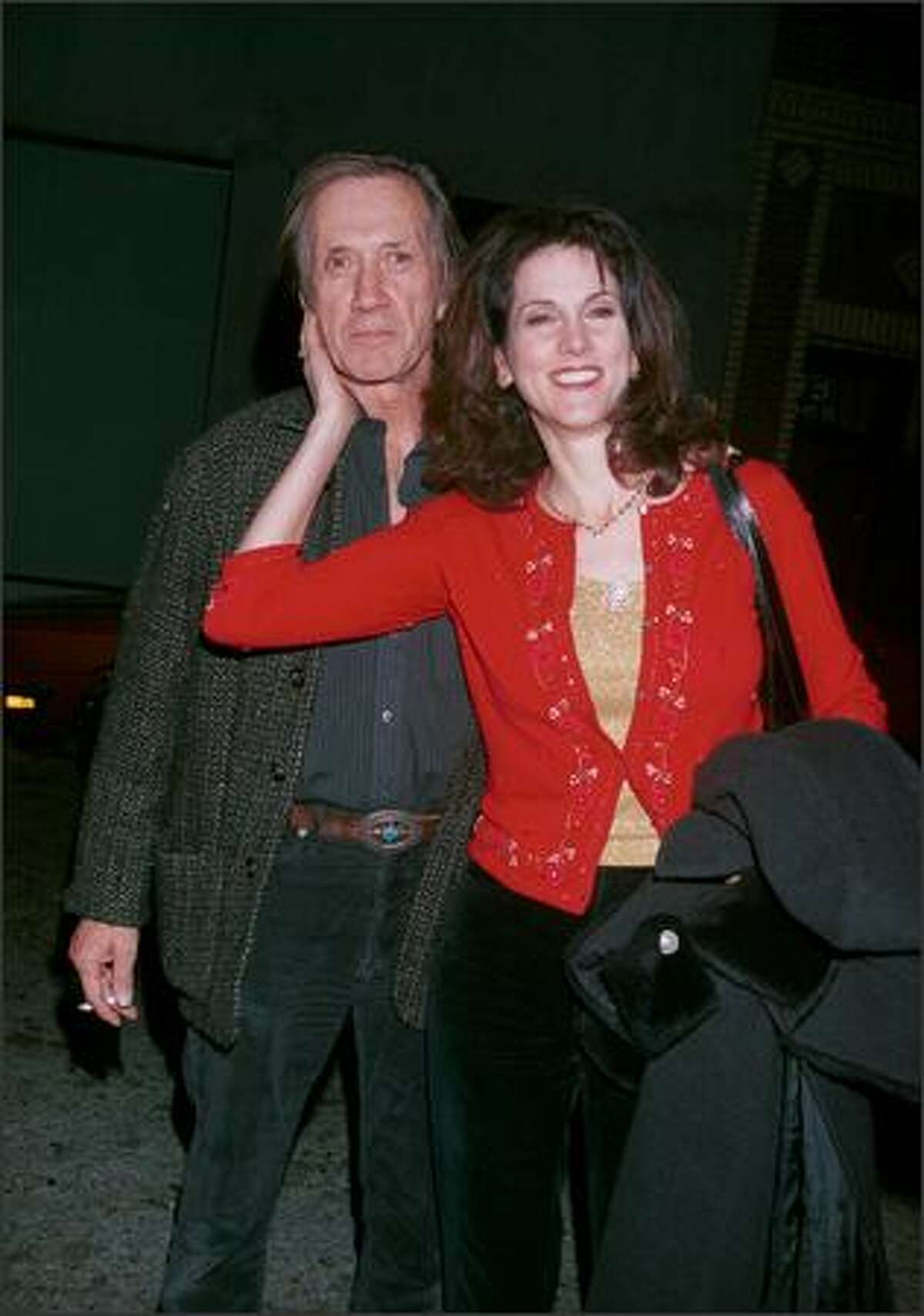"""Actor David Carradine and his fourth wife, Marina, attend a party and final shoot for """"Joe Head Goes Hollywood"""" Dec. 17, 2000 in Venice, Calif. (Photo by Newsmakers)"""