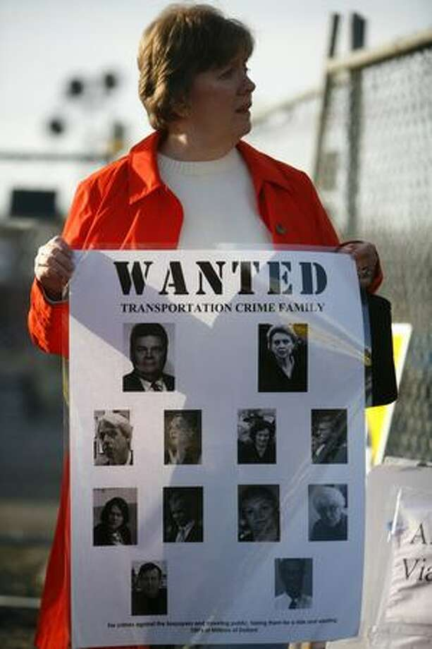 Elizabeth Campbell, of Seattle Citizens Against Tunnelling (SCAT), holds a protest sign during an event on Saturday October 24, 2009. Washington State Governor Chris Gregoire and Seattle Mayor Greg Nickels, backed by the City Council, signed a memorandum agreeing to build a deep-bored tunnel to replace the aging structure. Photo: Joshua Trujillo, Seattlepi.com