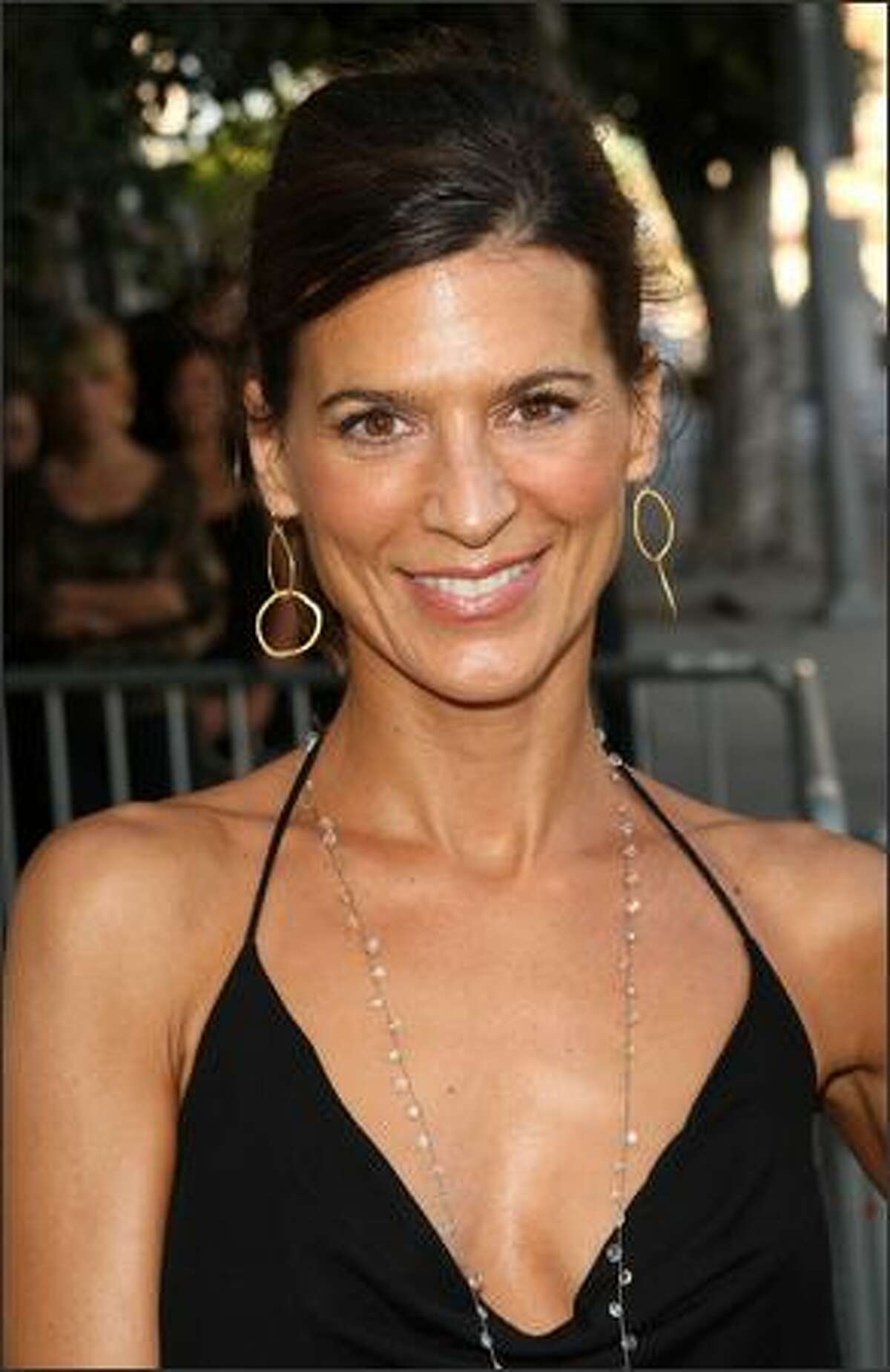 Actress Perrey Reeves attends.