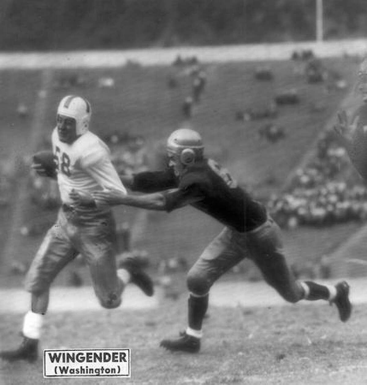 John Wingender (58) Washington halfback, speeds on his way for a gain against California. The Oct. 1945 game was in Berkeley.