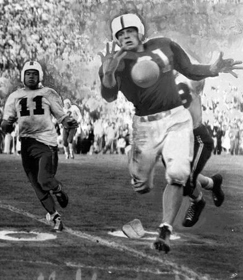 Husky end Bob Nelson makes a near catch during a Sept. 1946 game against St. Mary's. Behind Nelson is Herman Wedmeyer, St. Mary's star. Photo: P-I File