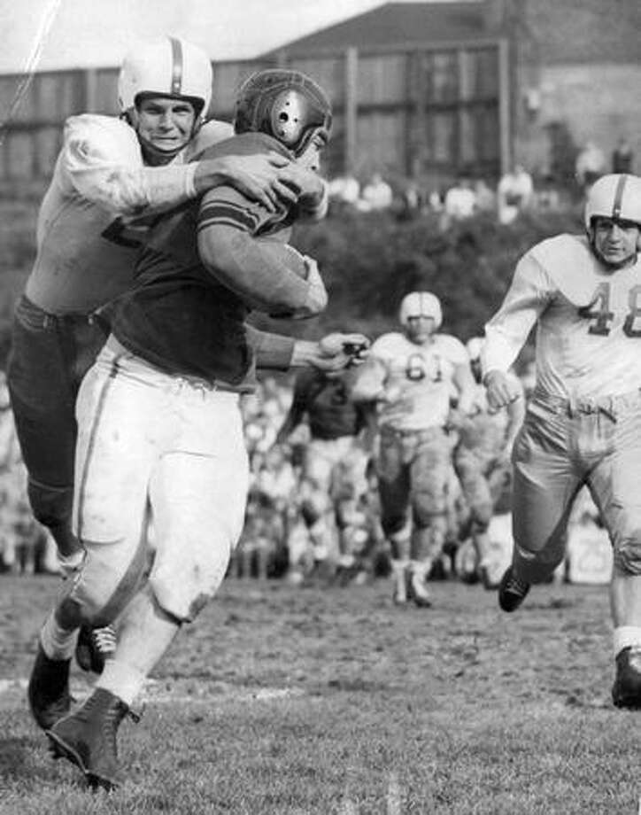 A scene from the 1948 UW game against Oregon State. Anse McCullough is No. 24. Photo: P-I File