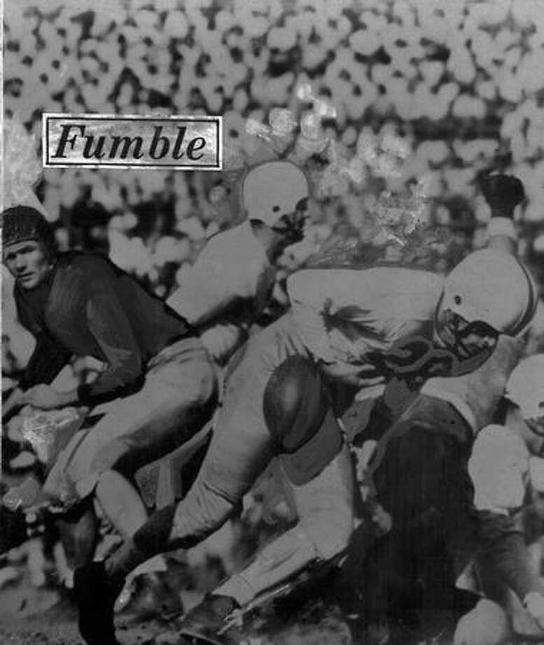 Washington quarterback Mike Scanlan (26) fumbles in a 32-7 less to USC, Nov. 1948. Photo: P-I File