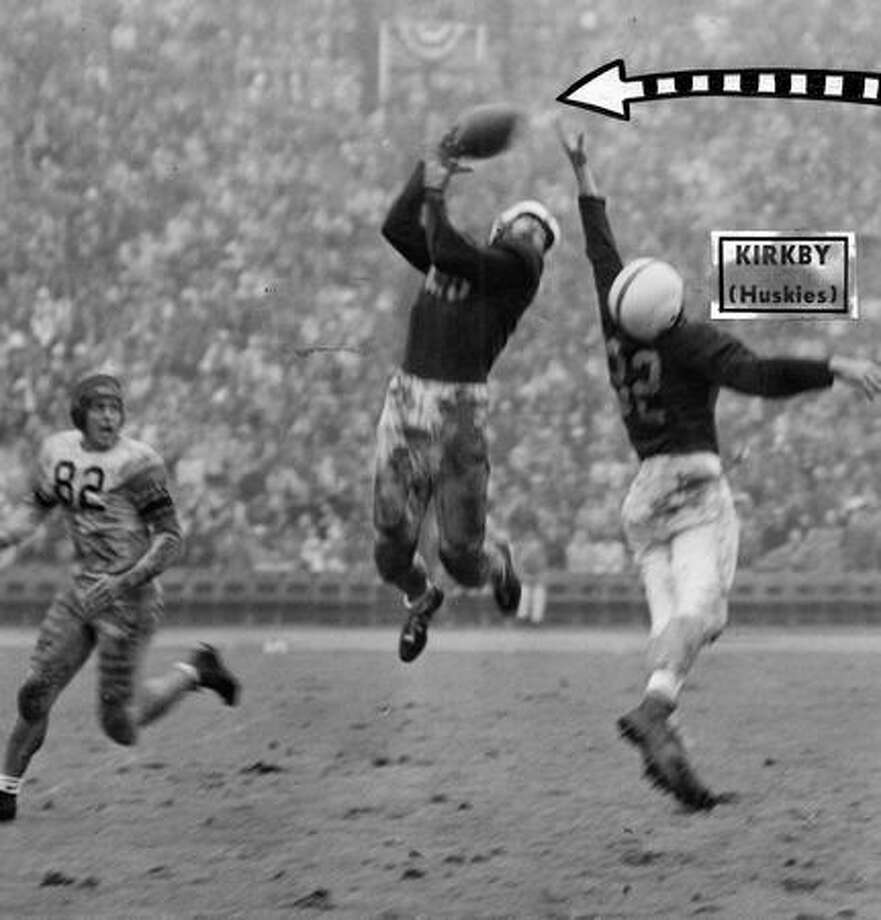 Washington's Larry Hatch intercepted this pass intended for California's Norm Pressley (82). UW player Roland Kirkby is on the right. California won the Oct. 1948 game 21-0. Photo: P-I File