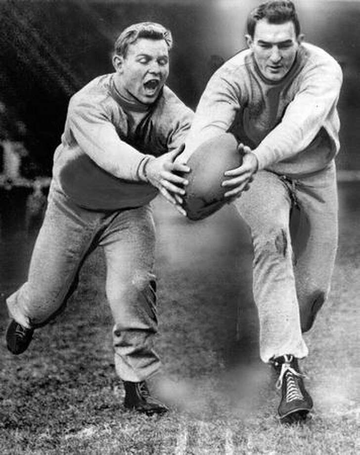 Alf Hemstad, left, and Chick Olson warm up for UW's 1948 game against Notre Dame. Photo: P-I File