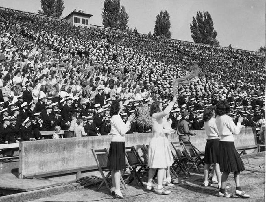 Football in wartime had its effect on the students rooting section yesterday with many of the fans being navy and marine trainees and naval reserves, Sept. 1943. Photo: P-I File