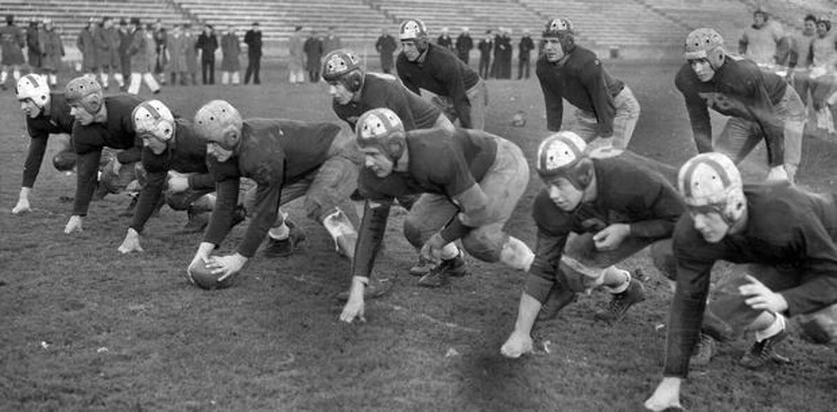 Coach Pest Welch during a Huskies practice.