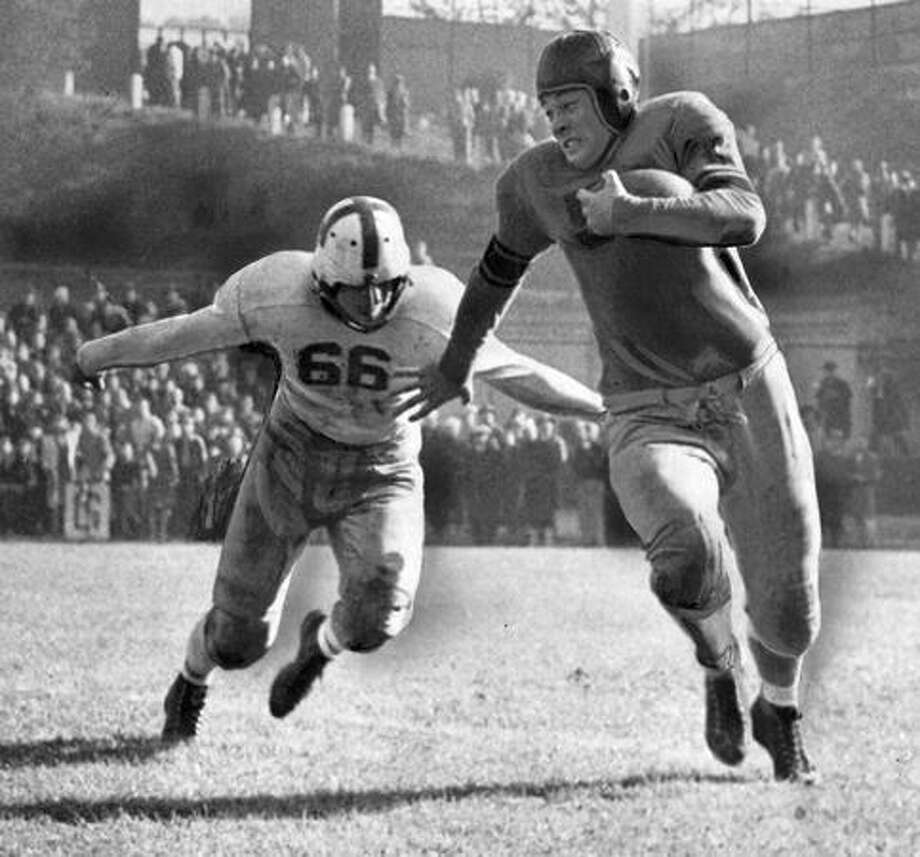 Alf Hemstad, University of Washington guard, comes up fast to make the tackle on Bob Remain as the Oregon State back attempts to skirt the Husky flank. Hemstad was a top kicker in the Oct. 1945 game. Photo: P-I File