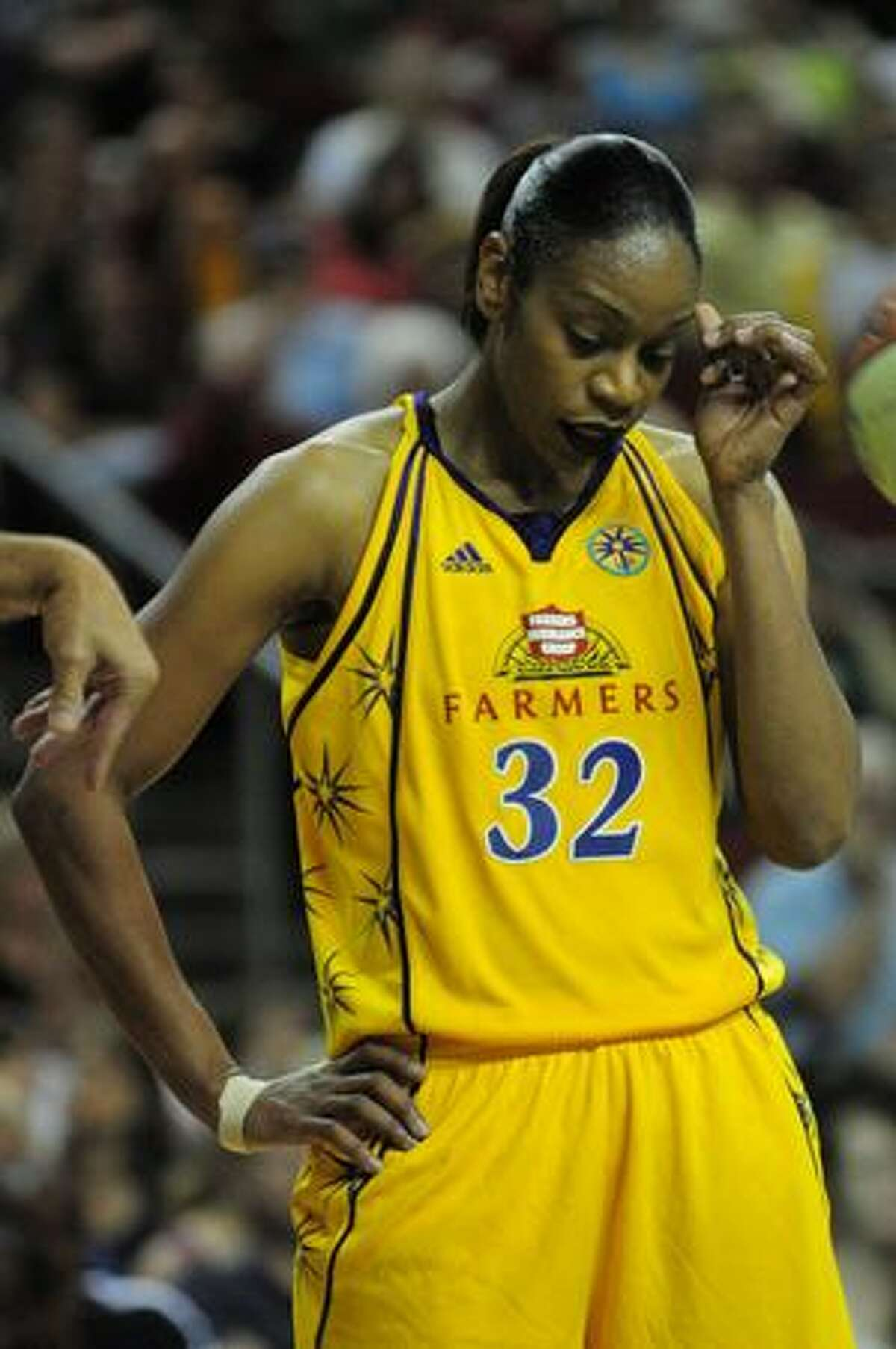 Tina Thompson of the Los Angeles Sparks reacts to a teammate missing a free throw in the 3rd quarter of play. Photo by Daniel Berman/SeattlePI.com