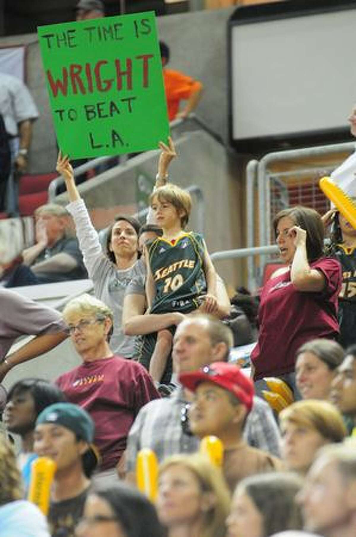 A Seattle Storm fan holds up a sign during the 3rd quarter of play. Photo by Daniel Berman/SeattlePI.com