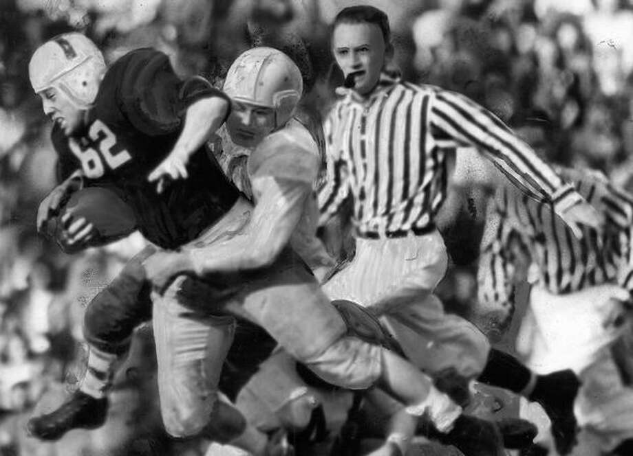 "Frosh Fullback Joe Trask was the most powerful runner on the field in an Oct. 1945 game against. Trask won a starting job ""as a result of his brilliant performance against the Cougars of averaging better than eight yards each time he carried ball,"" according to a P-I article at the time. Photo: P-I File"
