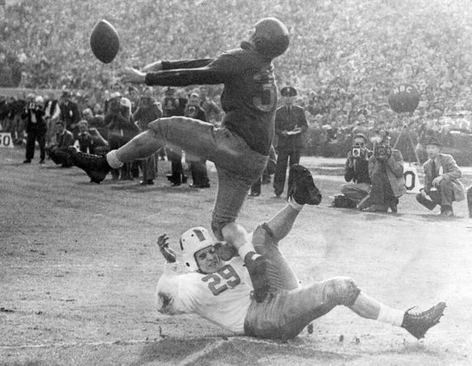 The closest the Huskies of Washington got to a touchdown in the Rose Bowl yesterday was when Dick Hagen (29) sat on the goal line as George Callahan of UCS broke up pass and stepped on Hagen's stomach. The previously unbeaten Huskies lost 29-0. Photo: P-I File
