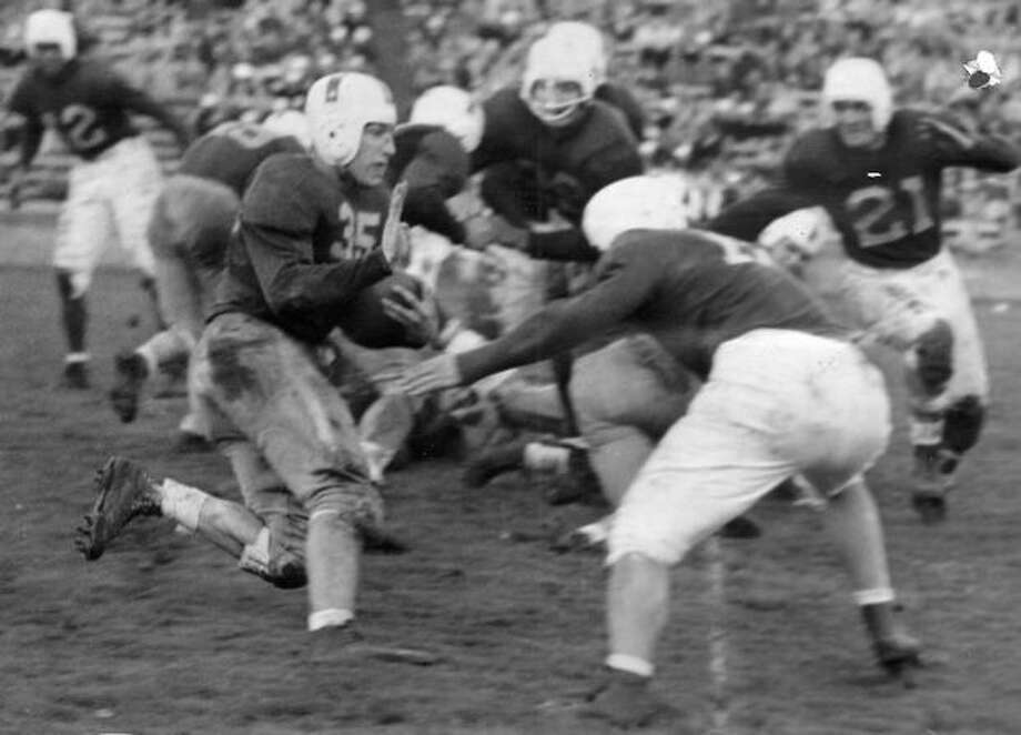 Dick Ottele, University of Washington halfback, could get no farther than the scrimmage line on this play in UW's Nov. 1944 game against March Field. Photo: P-I File