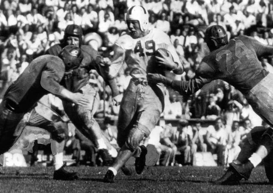 "Dick ""Whitey"" King, elusive Husky halfback, smashed his way for 5 yards on this second quarter play in an Oct. 1944 game against California. Washington trounced the Bears 33-7. Photo: P-I File"