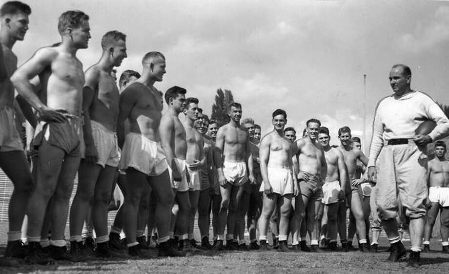"Coach Ralph ""Pest"" Welch and his team during a 1944 summer workout. Photo: P-I File"