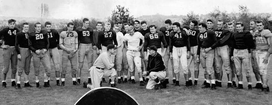 Assistant Coaches Art McLarney and Johnny Cherberg with top Husky recruits, Sept. 1946. Photo: P-I File
