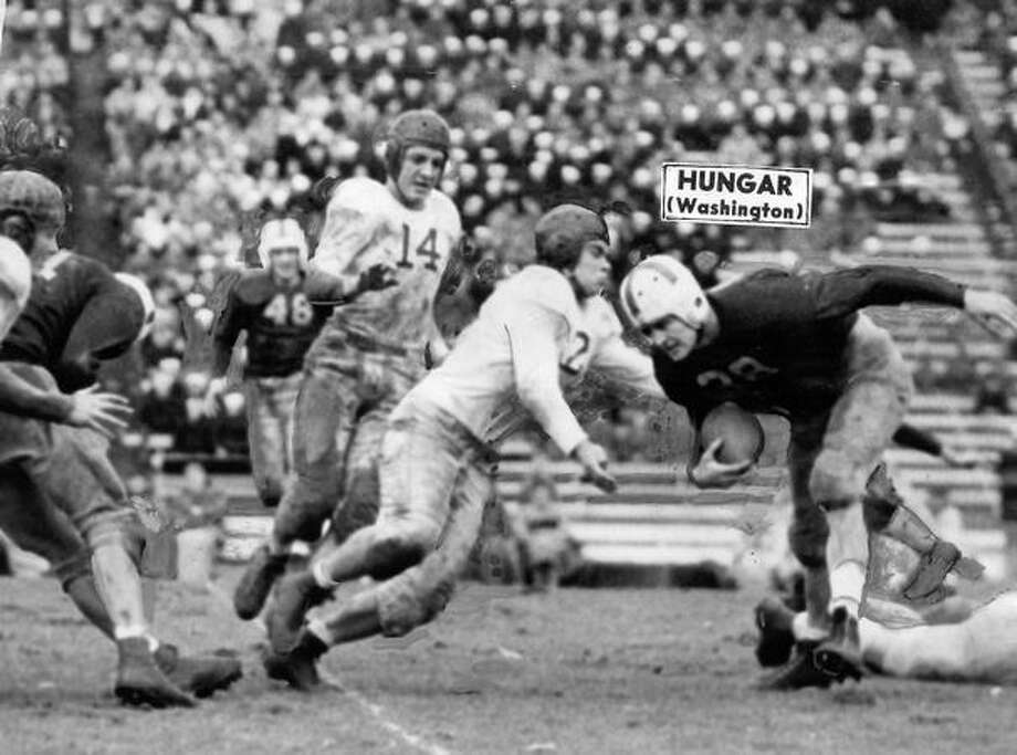 Gordie Hungar, Washington halfback, goes for an 8-yard gain in a 1945 game against Idaho. UW won 12-0. Photo: P-I File