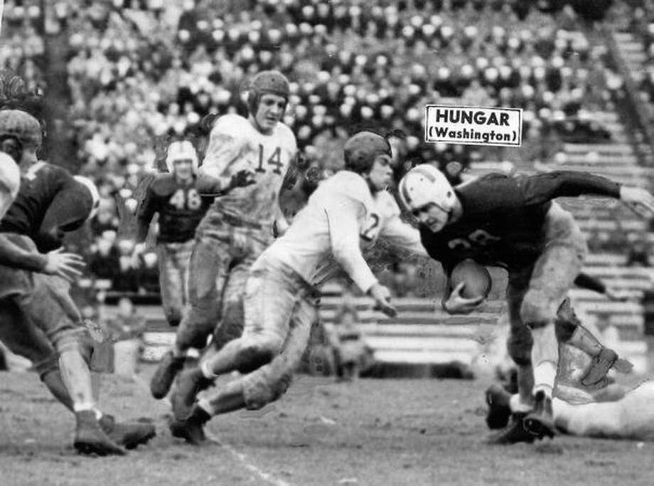 Gordie Hungar, Washington halfback, goes for an 8-yard gain in a 1945 game against Idaho. UW won 12-0. Photo: P-I File